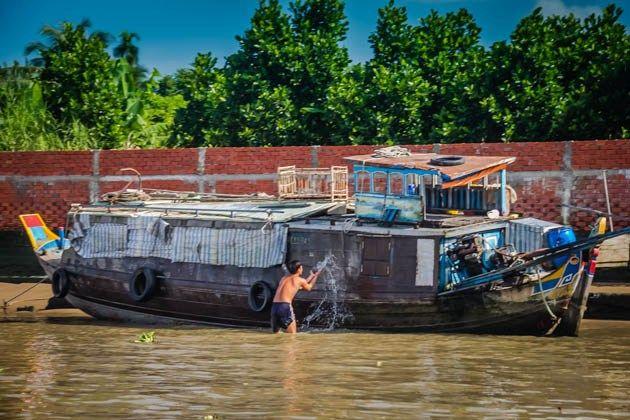 Mekong Delta Mekong Eyes Vietnam http://www.divergenttravelers.com/colors-mekong-delta-photo-essay/ #mekongdelta #Vietnam #mustsee #riverboat #handspandtravel #divergenttravel #divergenttravelers #bestblogpostof2014 #bestblog #mustread #travel #photos #mekongeyes #boat