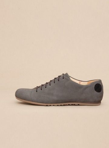 Handmade with calfskin lining, supple nubuck leather and a debossed