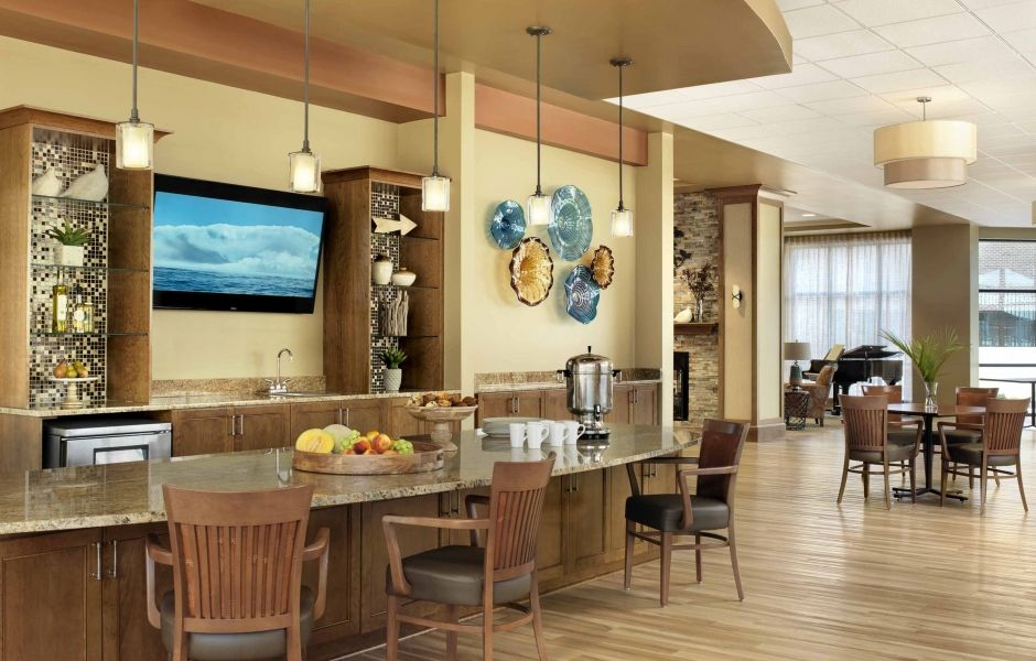 Cafe hospitaity interior design by spellman brady - Senior living interior design firms ...