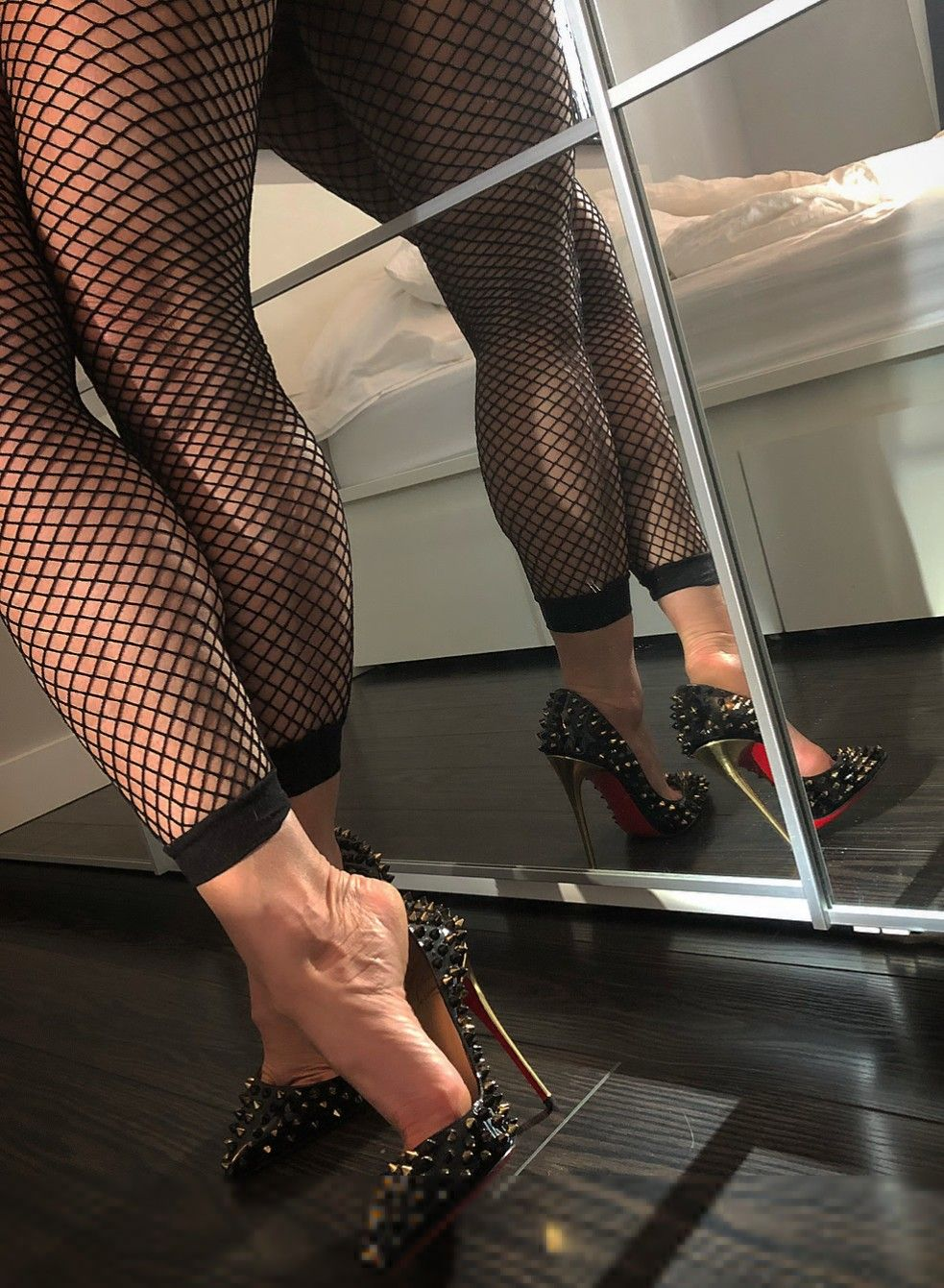 Legs sexy in fishnet stockings free image