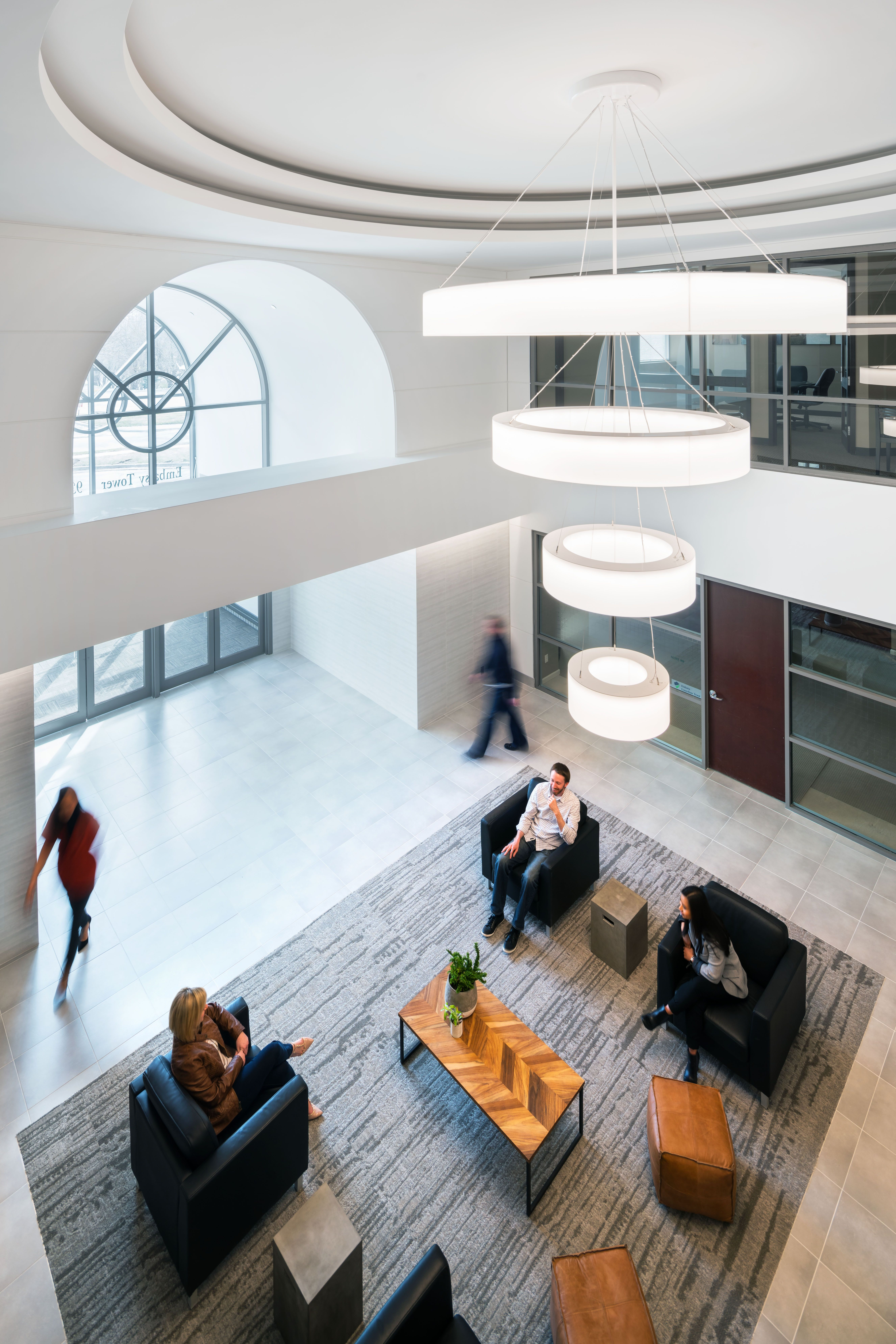 Novato Tier Chandelier is a statement fixture in a lobby, while also delivering performance and reducing need for additional fixtures in space