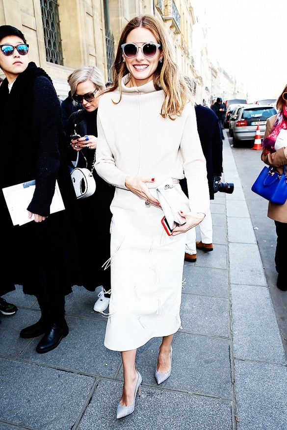 Olivia Palermo wears a turtleneck sweater, accented Tibi pencil skirt, and gray accessoires