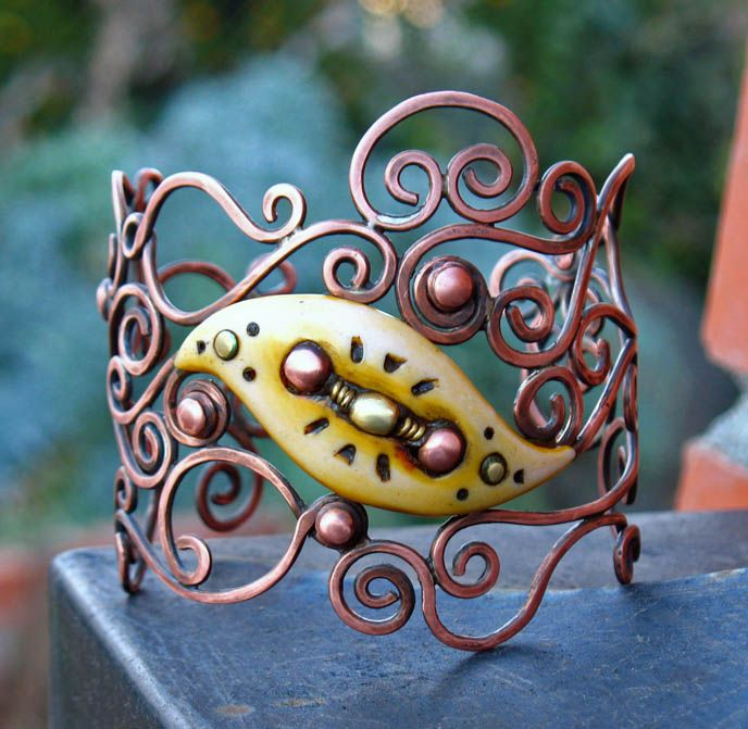 Cuff |  Desiree McCrorey.  Copper filigree cuff with polymer clay focal.