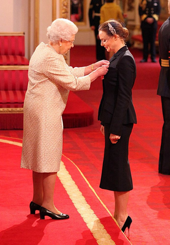 DESIGNER STELLA McCARTNEY RECEIVES THE OBE FROM HM QUEEN ELIZABETH TODAY, MARCH 27, AT BUCKINGHAM PALACE. Stella wore an outfit from her collection. Dad, Paul McCartney must be very proud.