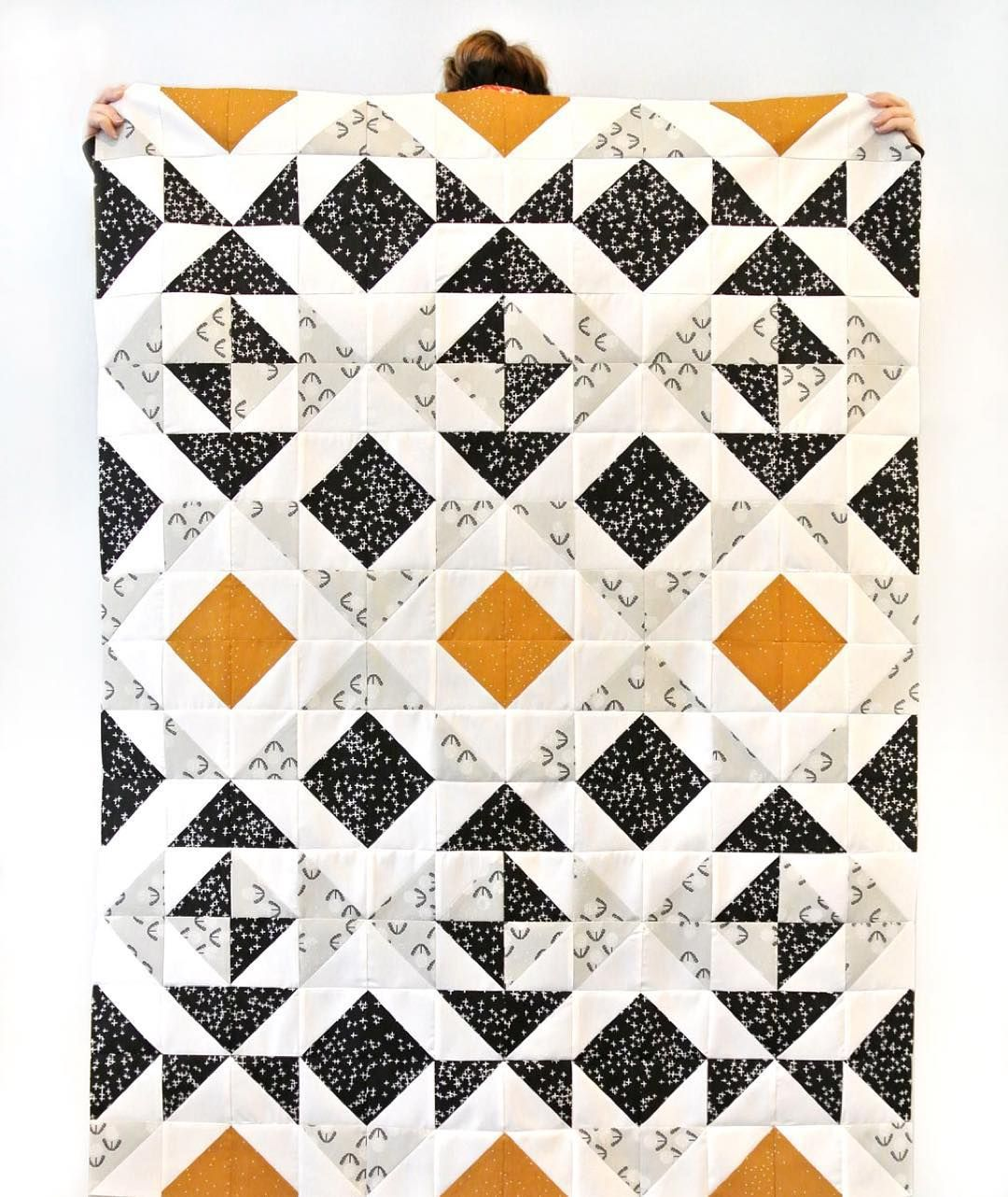 You can make this quilt or others like it using the Nordic Triangles Quilt…