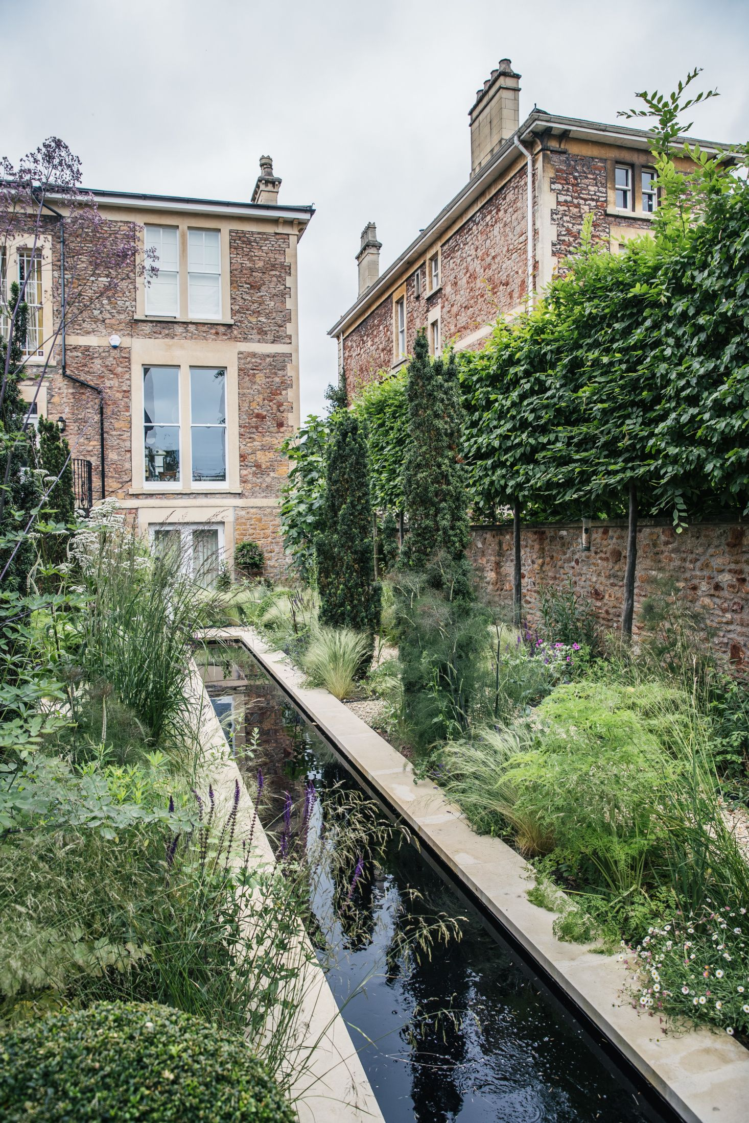 Before & After A Modern Courtyard Garden for a Historic Home is part of Courtyard garden Pool - For their historic home in the enclave of Clifton in Bristol, UK, an energetic couple wanted an informal landscape where their grandchildren and dogs could