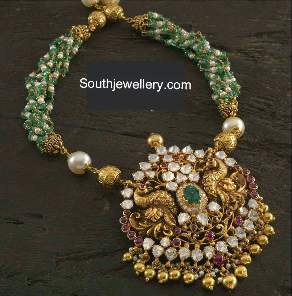 Beautiful 22 carat gold chains with matching pendant designs latest - 22 Carat Gold Beads Necklace With Multiple Twisted Chains Of Pearl And Emerald Beads Attached