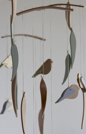 Photo of Eucalyptus leaves and birds mobile