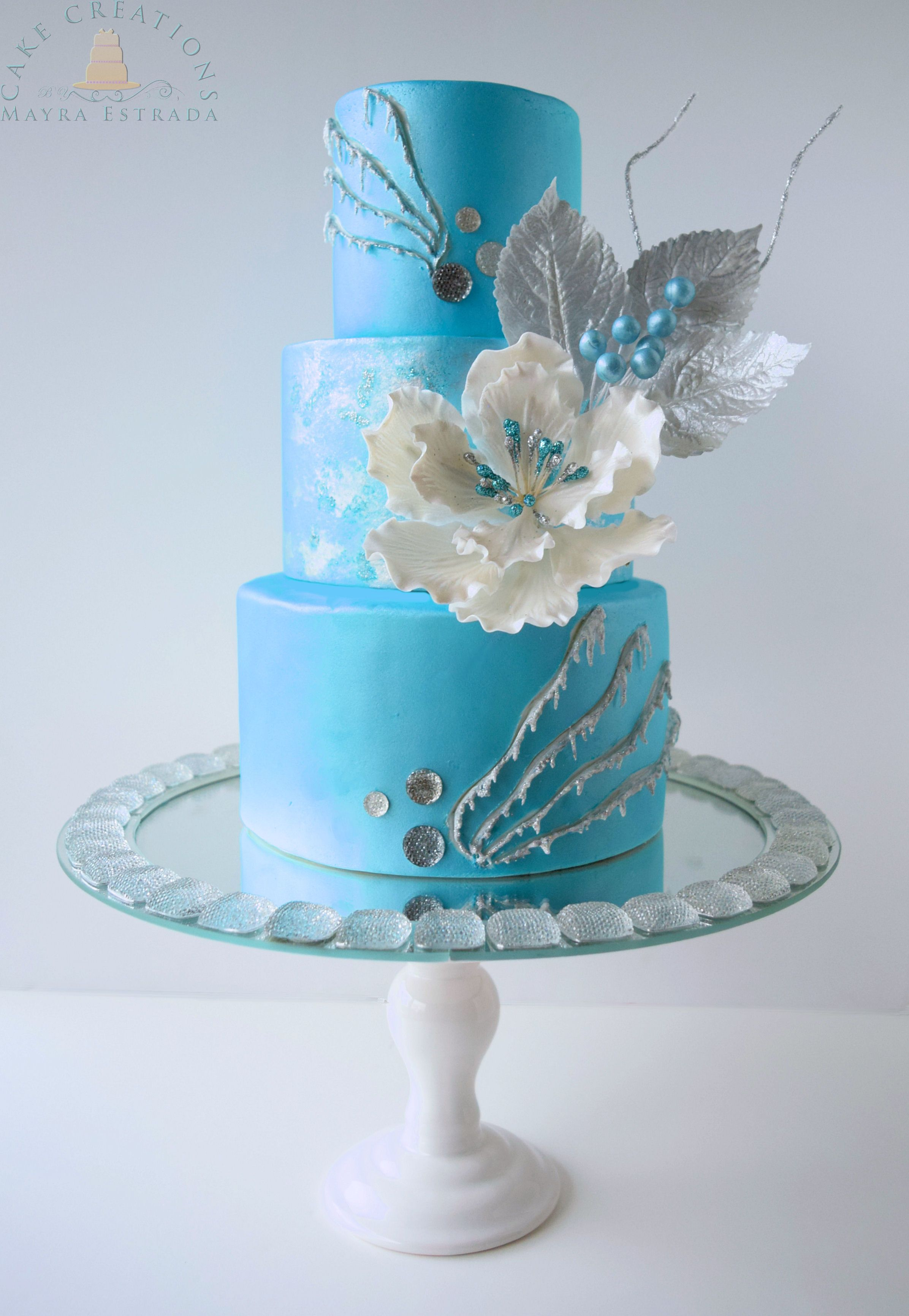 Sky Blue Wedding Cake With White Flowers