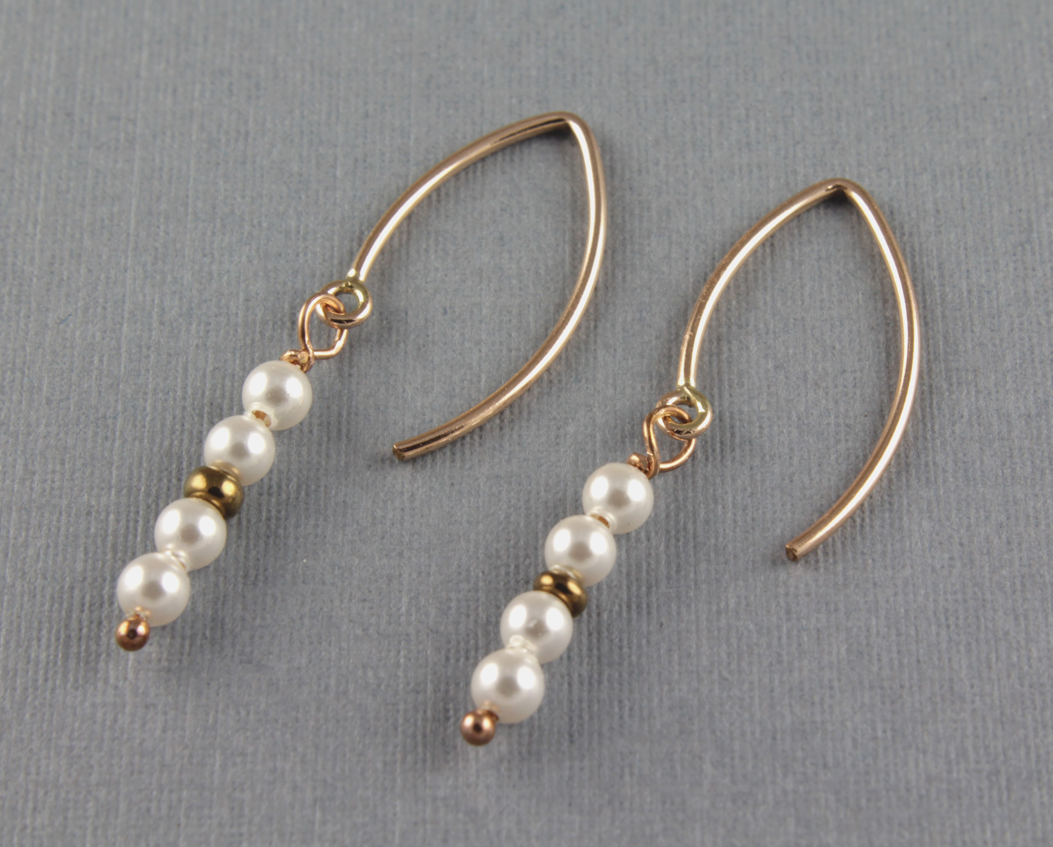 Delicate White Pearls Dangle Earrings The simplicity of these