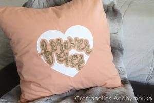 14 Valentine's Day Decor Ideas To DIY: heart wreath, cork heart, leather heart placemat, accent pillows, heart cake stand, xo art, kiss art and more.: Valentine's Day Decor To DIY:Forever Ever Pillow