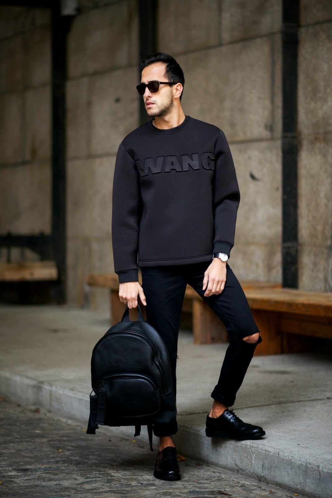 teams a black embossed sweashirt with an edgy backpack for an unmistakably  urban vibe. Alexander Wang x H M. 0e86a60d7e