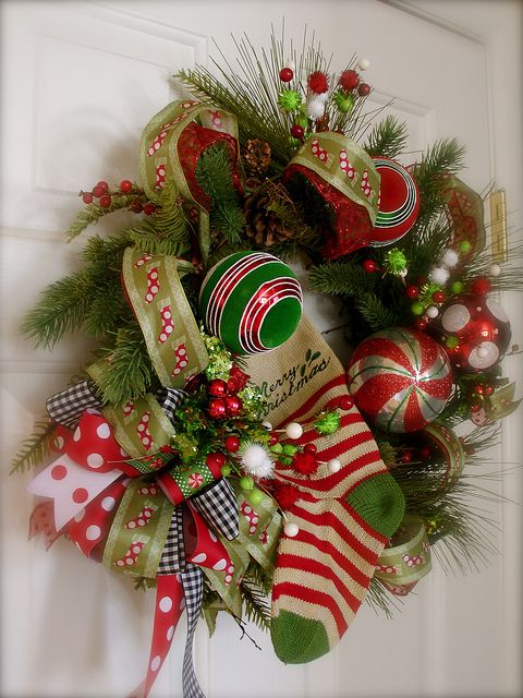 Christmas wreath- the black/white checked ribbon is unexpected and adds balance to the reds and greens