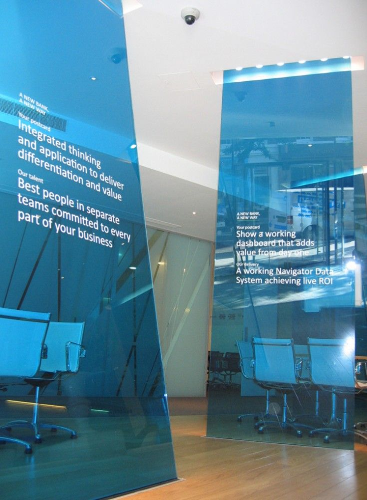 Blue semi opaque divider walls in office space interiors for Office design exhibitions