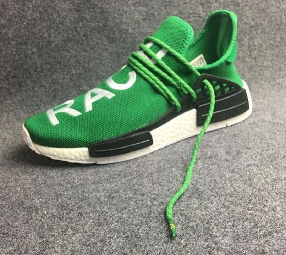"""Pharrell's suave touch lands on the adidas NMD Primeknit with a new """"cage""""  that features thick rope laces and HUMAN RACE embedded into the knit uppers."""