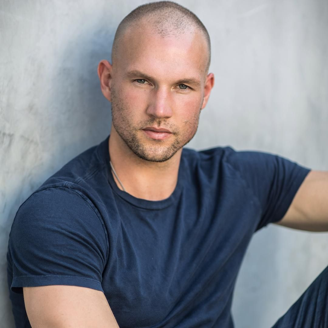 I have a thing for shaved head men