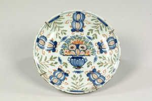 A LATE 19TH-CENTURY ITALIAN BLUE-PAINTED MAIOLICA DOUBLE WALL-POCKET of addorsed dolphins form,