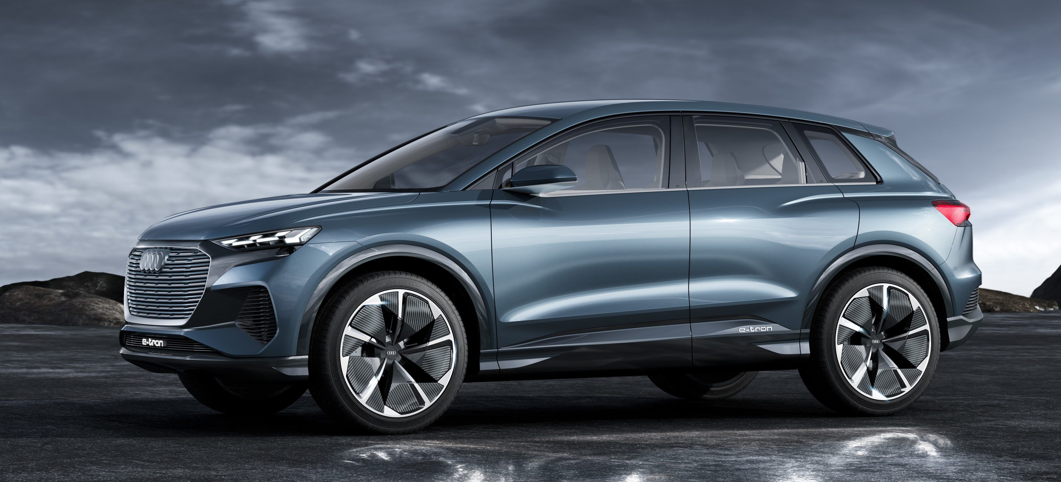 Audi Unveils Small Electric Q4 E Tron Suv With 280 Miles Of Range Audi Q4 Electric Cars Affordable Suv