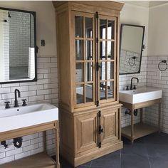 Bathroom inspiration...planning process! Serious DREAM! #gorge #iwishidesignedthis #bathroom #dream #restorationhardware #cabinetry #subwaytile #sinks #bath #spa #vintage #decor #design #interiordesign #mirrors #traditional #blackandwhite #oak #bleachedoak image found on @cookbonnerconstruction #modernbarn #modernfarmhouse