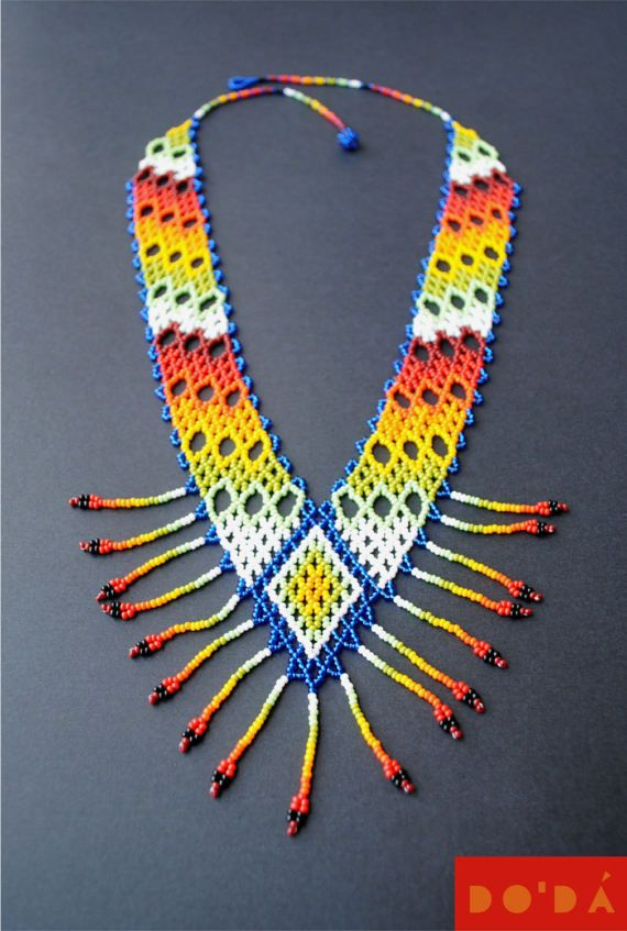 ● D E S C R I P T I O N This gorgeous hand-beaded necklace is handmade for Embera indigenous in Colombia with Thousands of Tiny beads / Este hermoso collar de chaquiras es hecho a mano por indigenas emberá en Colombia con millones de pequeñas chaquiras The embera indigenes transmit their culture and life to this pieces by means of colors and shapes / los indigeneas emberá trasmiten su cultura y vida a estas piezas por medio de los colores y las formas. Embera means The People of M...