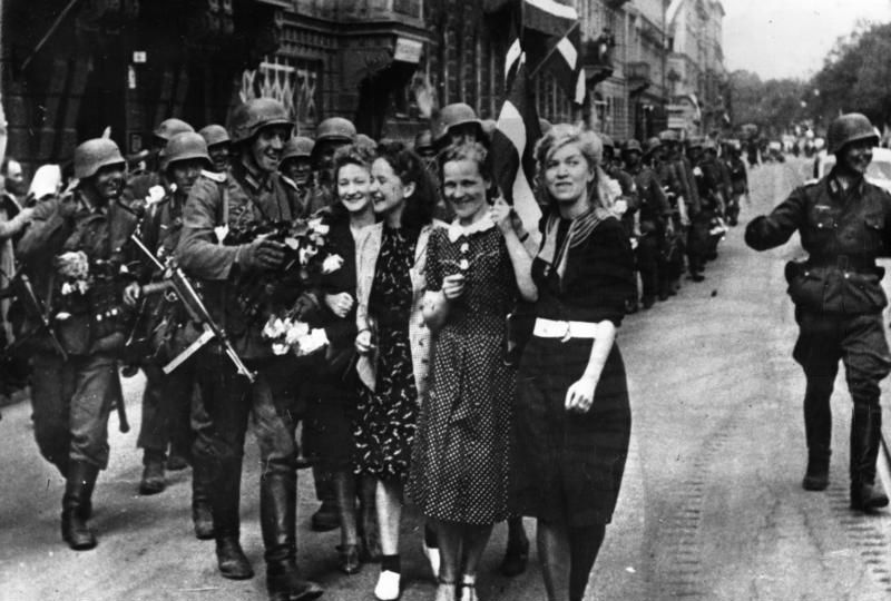 Latvian women welcome German soldiers marching into Riga in July 1941. Baltic states welcomed the German army as liberator from the Soviet yoke. The Waffen SS particularly benefited from the willingness of many Baltic men to join German ranks as volunteers.