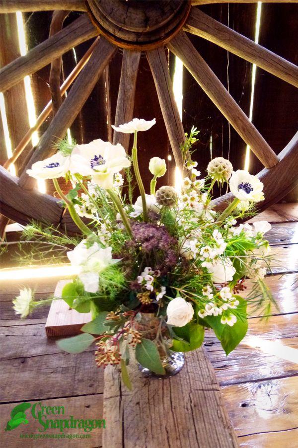 Centerpiece In Mercury Glass Vase With Anemones Nigella Wax Flower