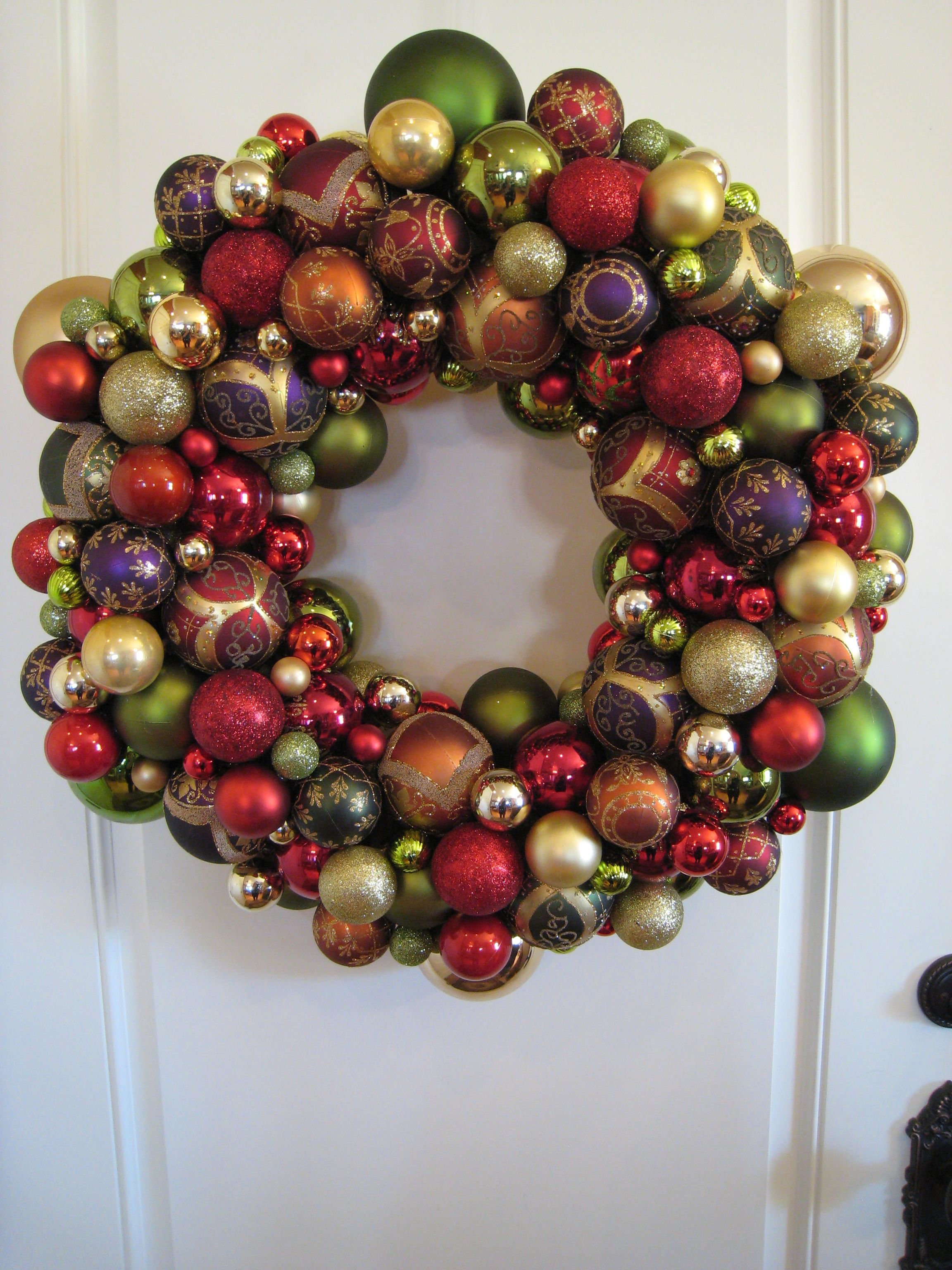 Styrofoam Wreath Wrapped In Ribbon With Christmas Balls Of All Sizes Christmas Wreaths Christmas Ornaments Christmas Projects