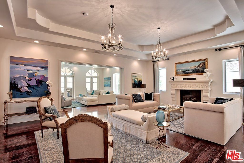 Dazzling White Furniture And Wall To Ceiling Painting Await In The