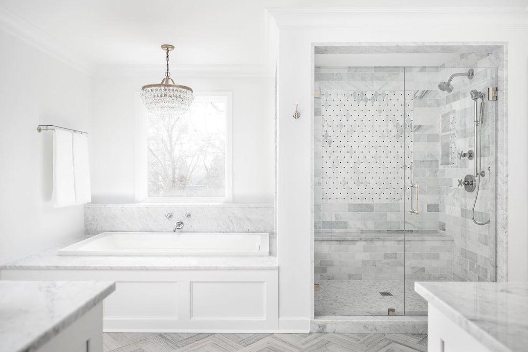 Bright White Bathroom Renovation With A Lake View Ahousebythelakeinteriors Photo By Tiffanyringwald Re White Bathroom Bathroom Renovation Bright White