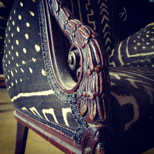 carved wood chair with black tribal pattern