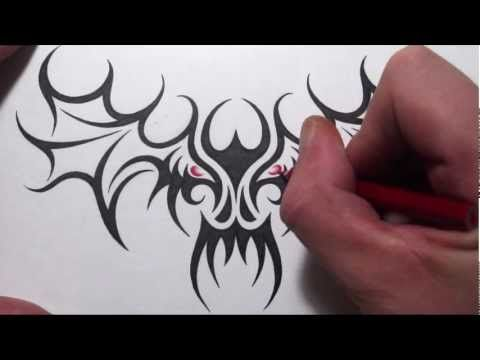 Drawing A Tribal Skull With Wings Tattoo Design Youtube Wings Tattoo Tribal Skull Tattoo Designs