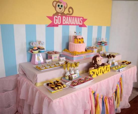 curious george inspired monkey party dessert table side view