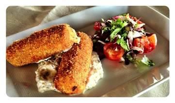 Fried #cod #croquettes with garlic and herb #aioli is one of the many delicious summer #menu items at Coba Restaurant in Viceroy Anguilla.