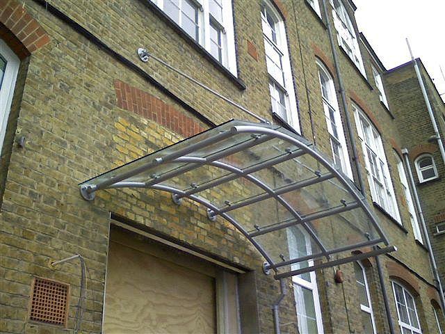 Canopy With Tubular Steel Powder Coated Frame Curved Glass Cover