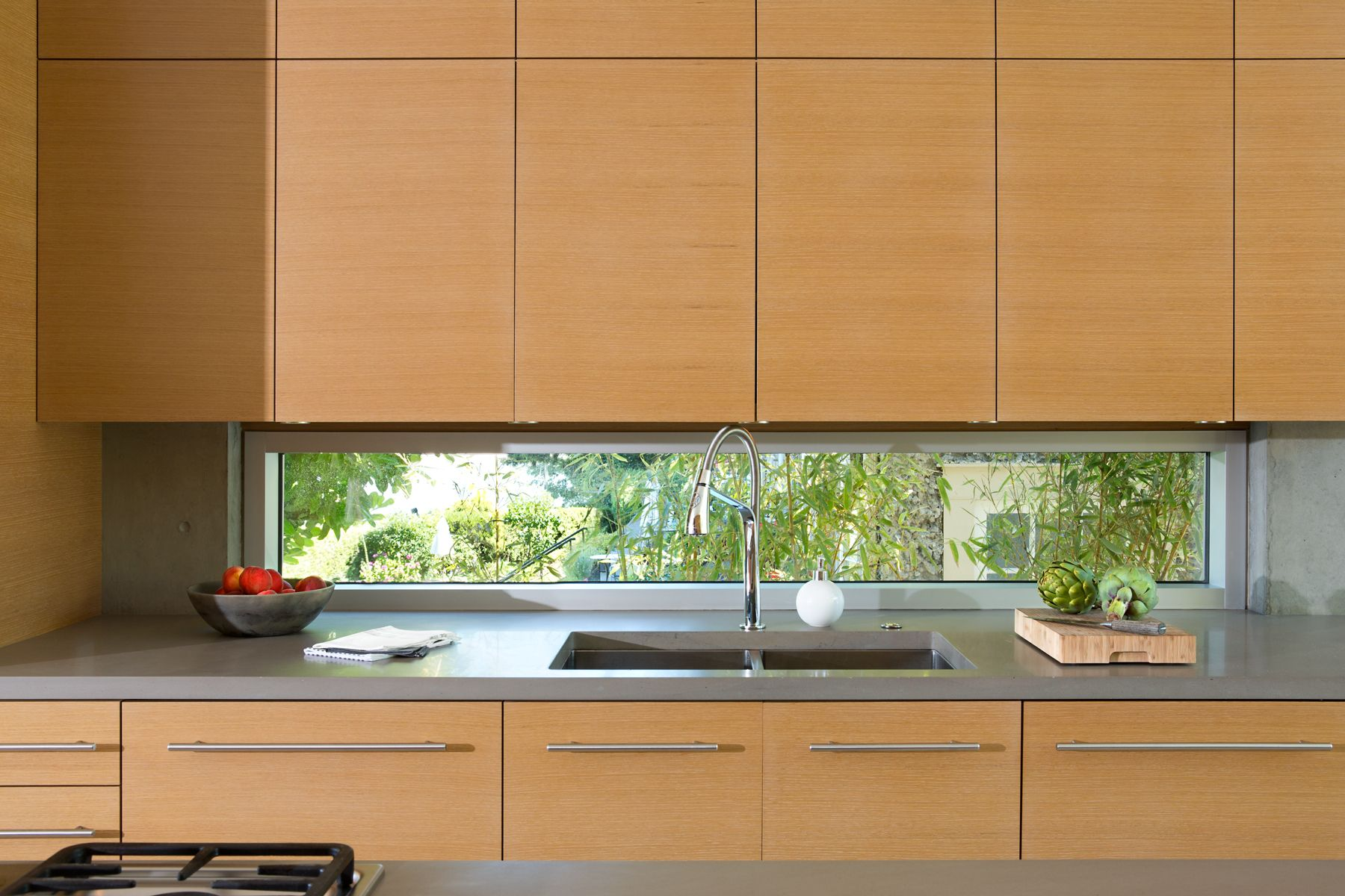 Slot window in kitchen designed to maximize great views while seated ...