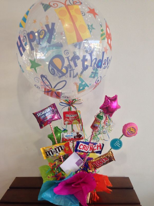 A funny candy bouquet.... a balloon with your favorites candies