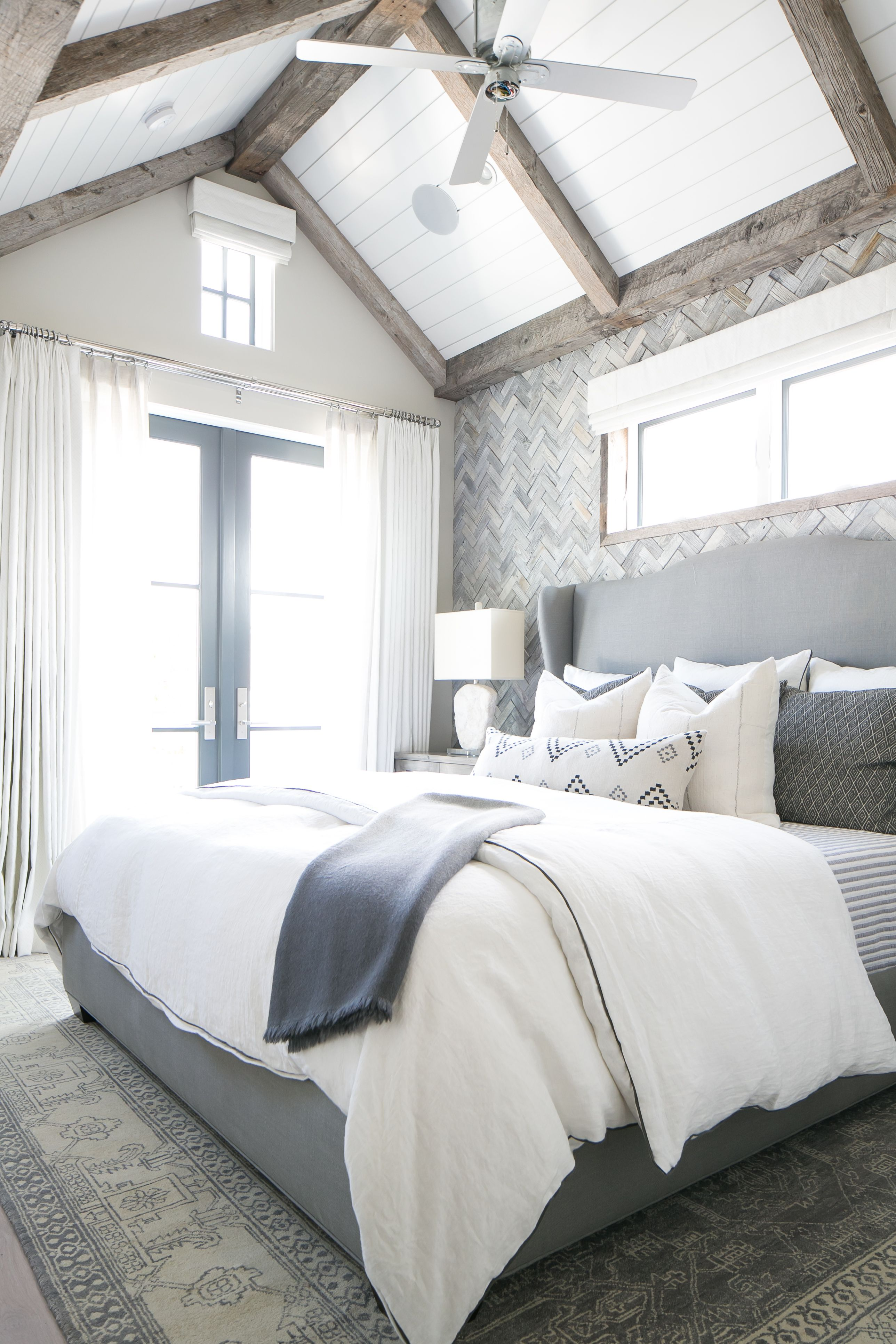 Master bedroom gray walls  The gray white and navy tones in this master bedroom are