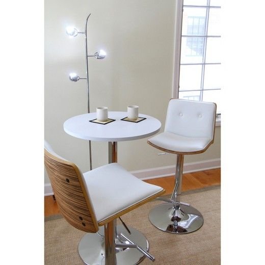 There's no more need to match the height of your chairs to the height of your table with the Adjustable Pub Table Black. This adjustable bar table is easily adjustable to give you and your guests the perfect height to reach for drinks and snacks, or to play a quick round of cards. Match this white table to all kinds of chairs for a sleek, modern look. The tabletop is a white-painted wood veneer and the legs and base come in classic silver metal. Sturdy and versatile, you'll wo...