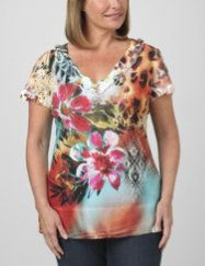 994a3f9c86 Spice up your wardrobe with this fiery choice. Vibrant tropical sublimation  print shimmers with a scattering of multi-color rhinestones.