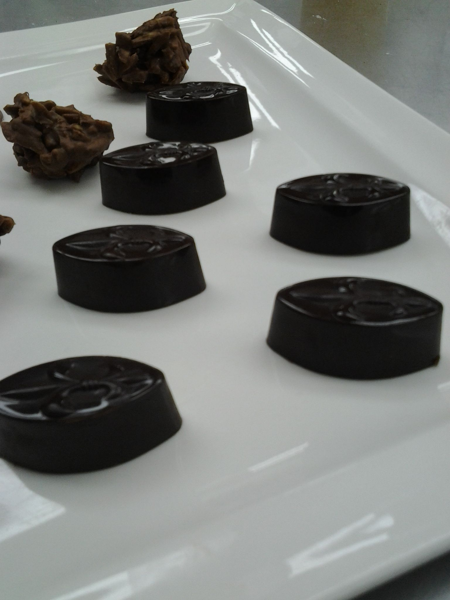 We use Fleur-de-lys molder for our dark chocolates pralines and filled with coffee ganache so seem like mocha pralines. this is one best creation we made