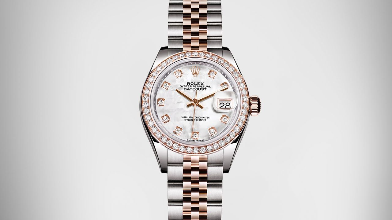 48c62075783 The Rolex Lady-Datejust 28 in Everose Rolesor with a diamond-set bezel and  a white mother-of-pearl dial.