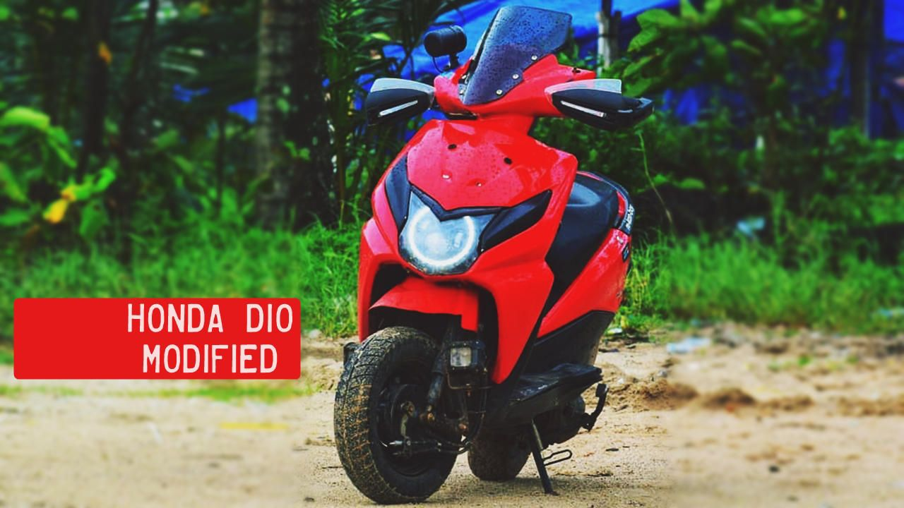 This modified honda dio has a restyled front fascia with custom led angel headlights longer windscreen extra led lights near the front wheel
