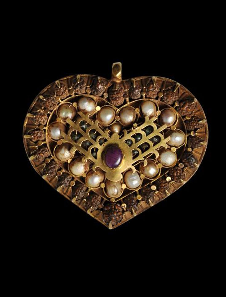 India | Heart-Shaped Temple Gold Pendant Set with a Ruby, Emeralds, Pearls & Rudraksha Seeds | 18th-19th century | Would have been commissioned as a gift to a south Indian temple to adorn a Hindu statue during a temple festival. | Sold