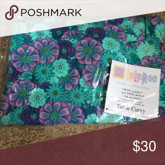 Lularoe TC Leggings *Brand New, Never Worn* LLR TC leggings featuring a pretty floral design in greens & purples with a little bit of yellow, coming from a smoke & pet free home. LuLaRoe Pants Leggings