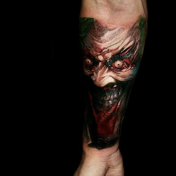 Colored Horror Style Creepy Looking Forearm Tattoo Of Colored