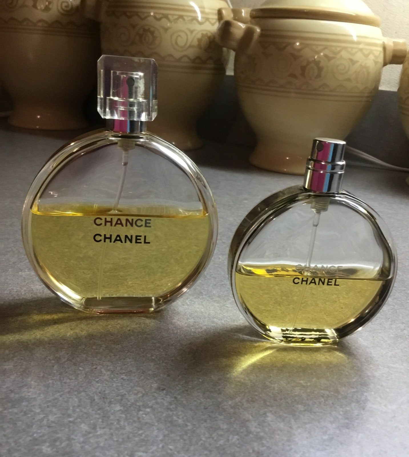 Set Of Two Chanel Chance 1 3 4 Fl Oz Bottle Over Half Full 2 1 7 Fl Oz Bottle About Half Full Both Bottles Chanel Perfume Bottles Metal Bands