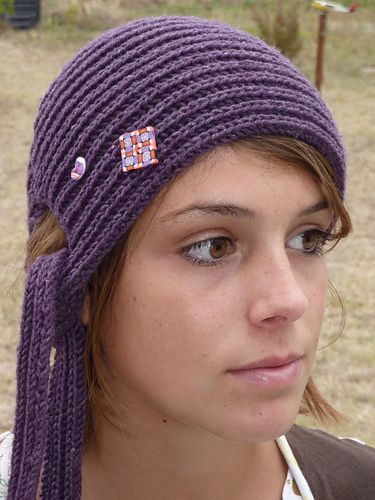 This hat is made from side to side, starting and ending with ties. The crown is shaped using short rows.