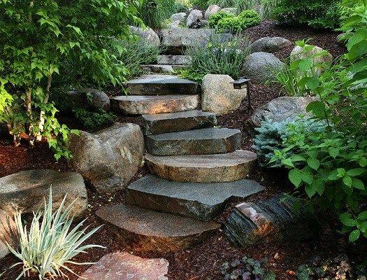 Enhance scenery at home through boulder landscape design for Sloped rock garden designs
