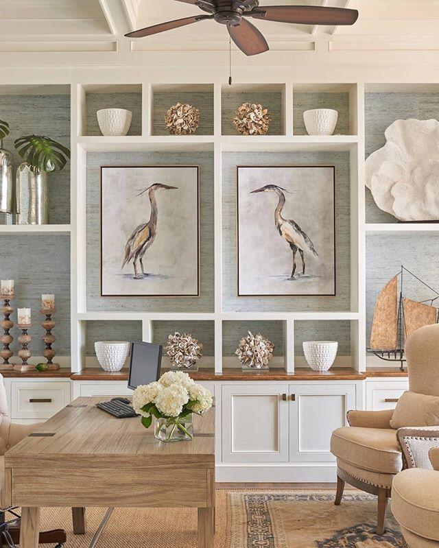 Layered rugs, oversized art, and symmetrical perfection of coastal