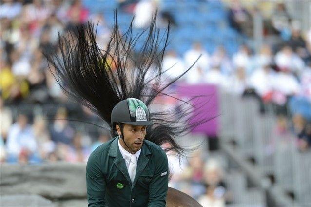 Have never seen such long hair on a jockey, lol!  #London2012